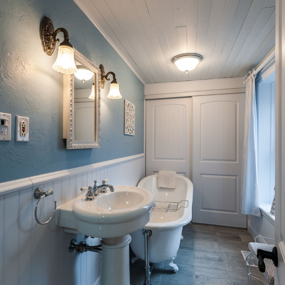 Bathroom With Turquoise Wall And Country Style Bath Tub And Basin