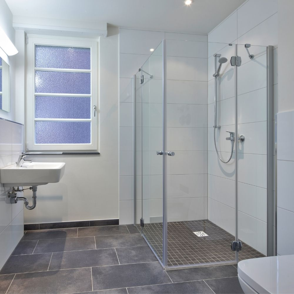 Bathroom With Walk In Shower And Rustic Gray Flooring
