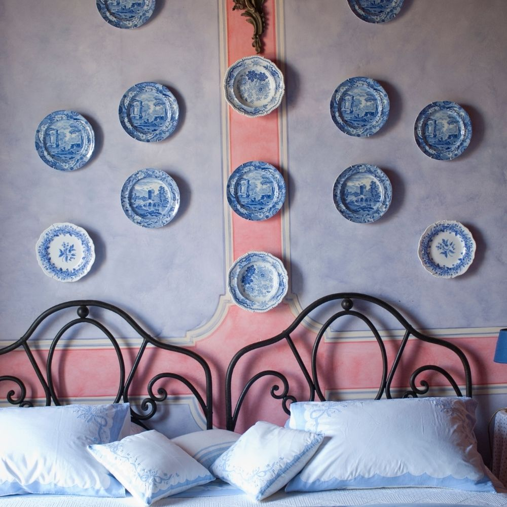 Blue Themed Bedroom With Overhead Decorations