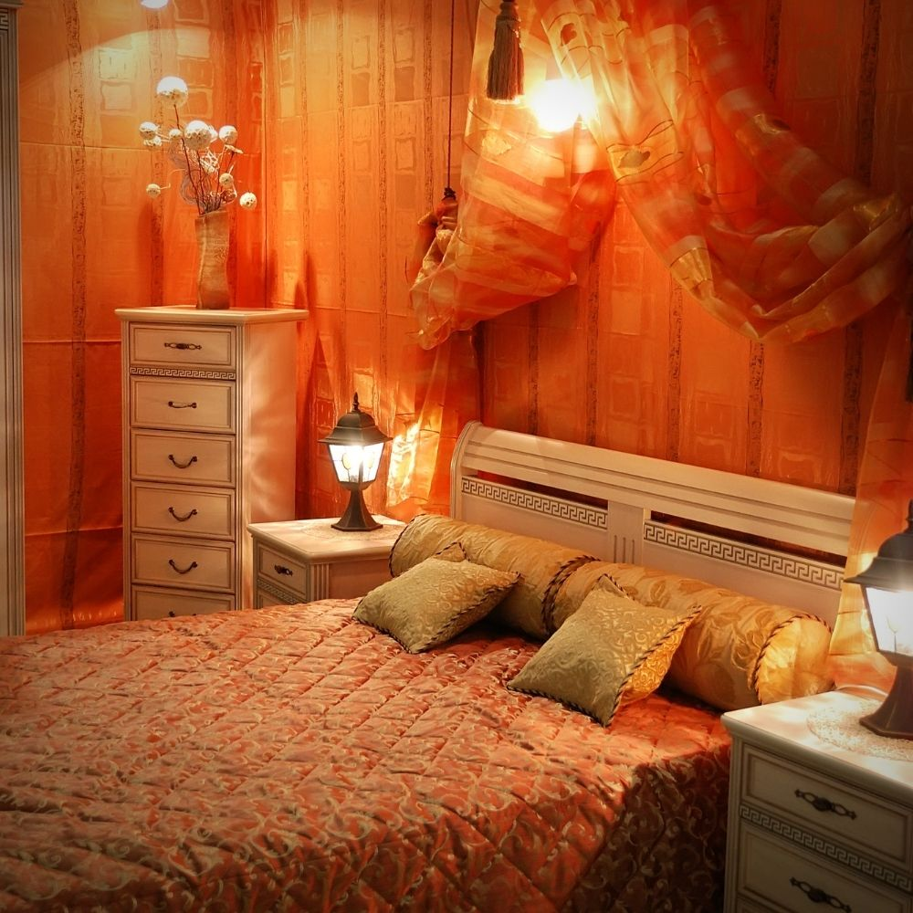 Classic Country Bedroom With Warm Wallpaper And Light