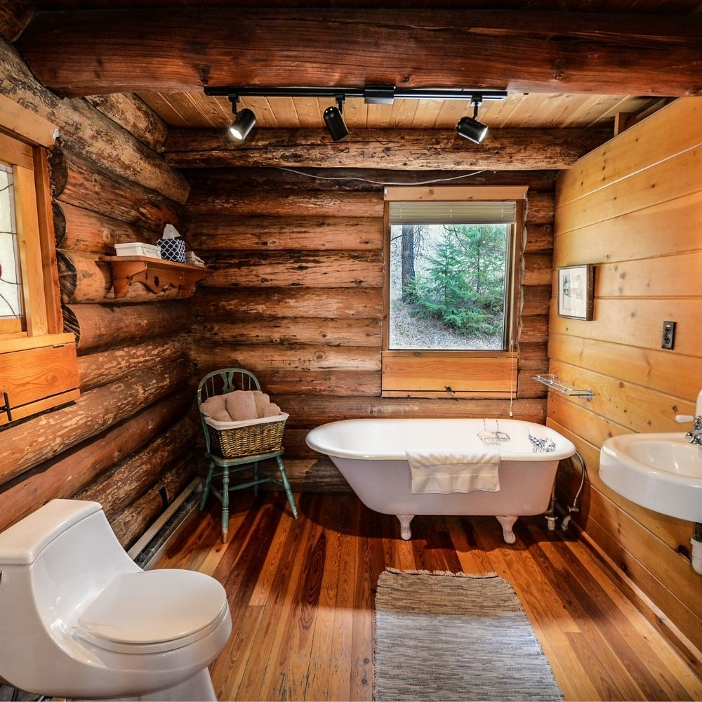 Country Bathroom With Exposed Wood Beams And Wood Panel