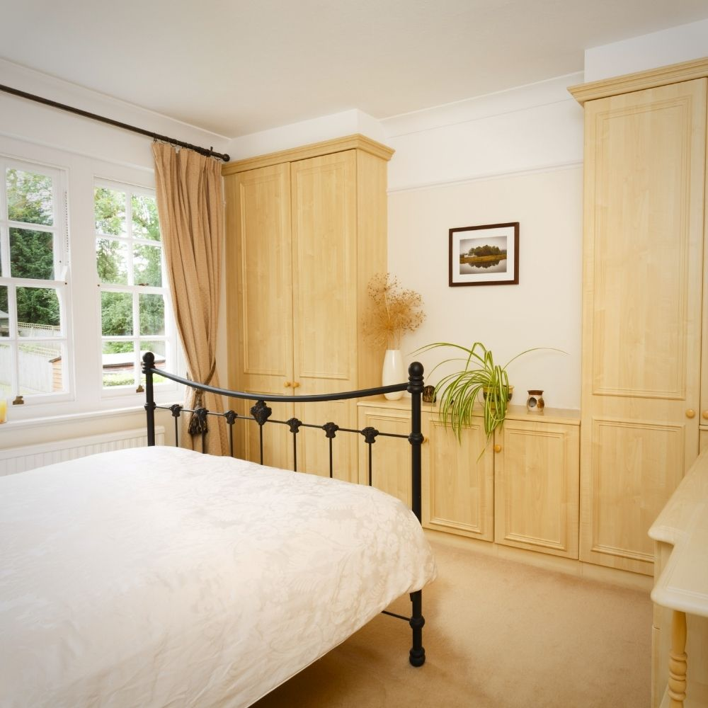 Neutral Country Bedroom With Natural Wood