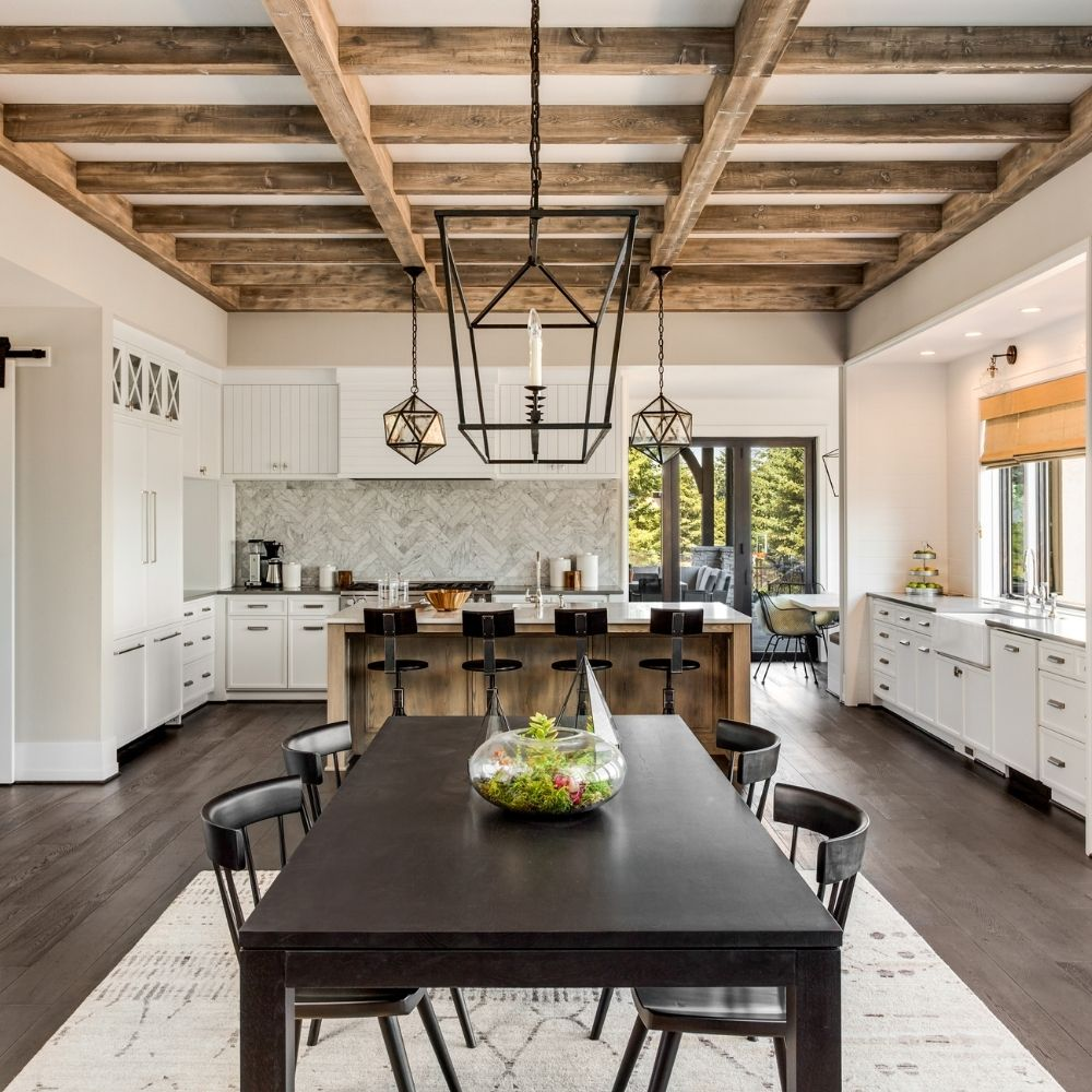 Open Plan White Kitchen With Exposed Wooden Beams