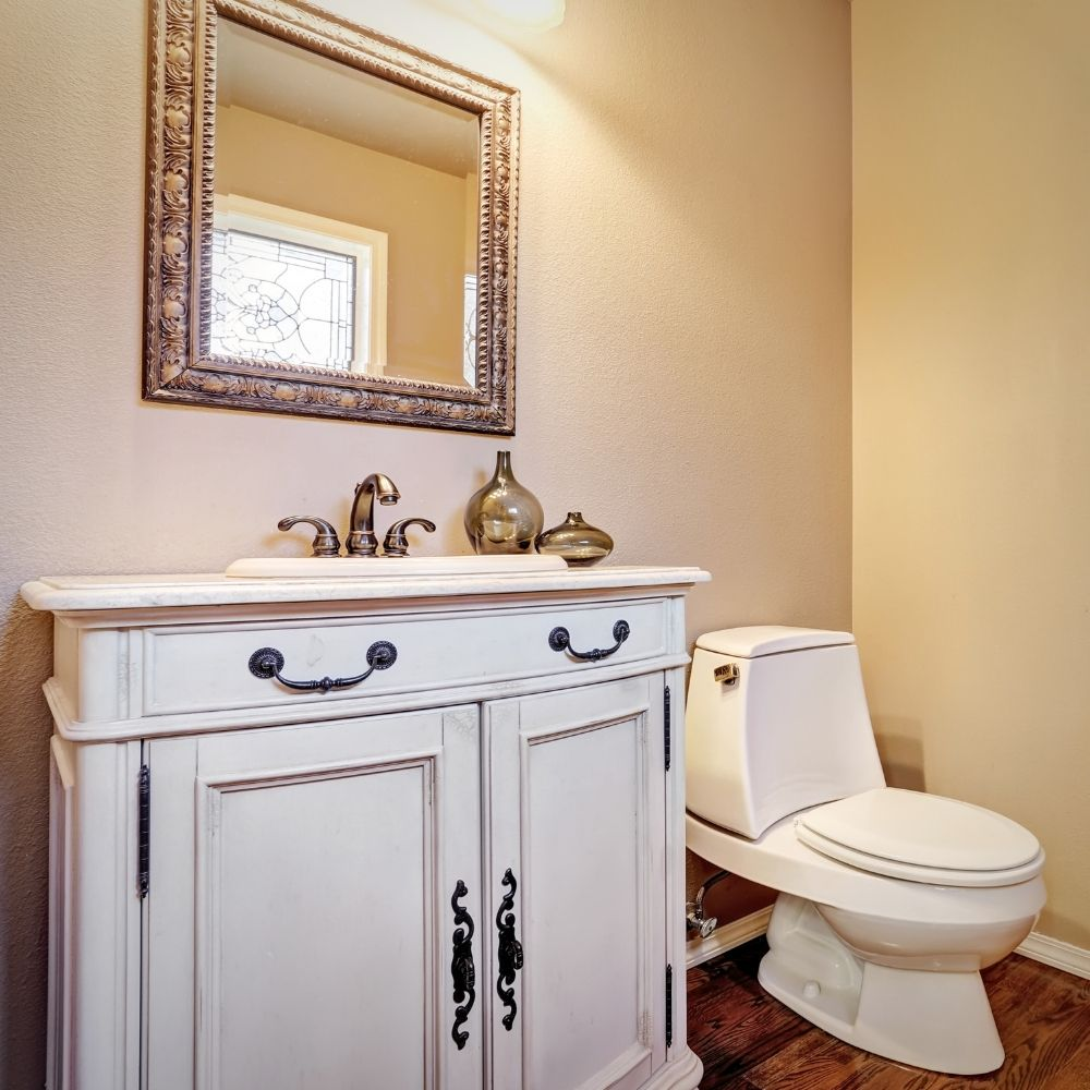 Traditional Bathroom With Rustic White Sink Cabinet And Copper Faucet