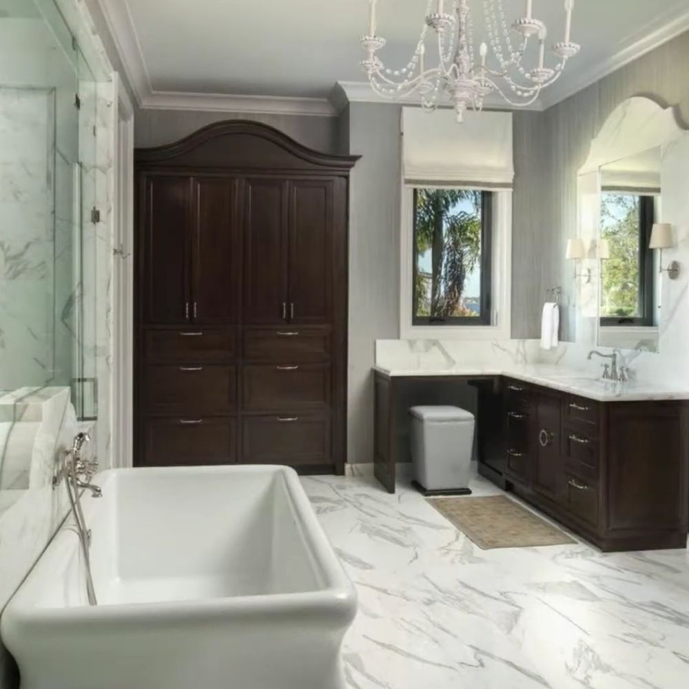 Traditional Bathroom With Wood Cabinet And Chandelier