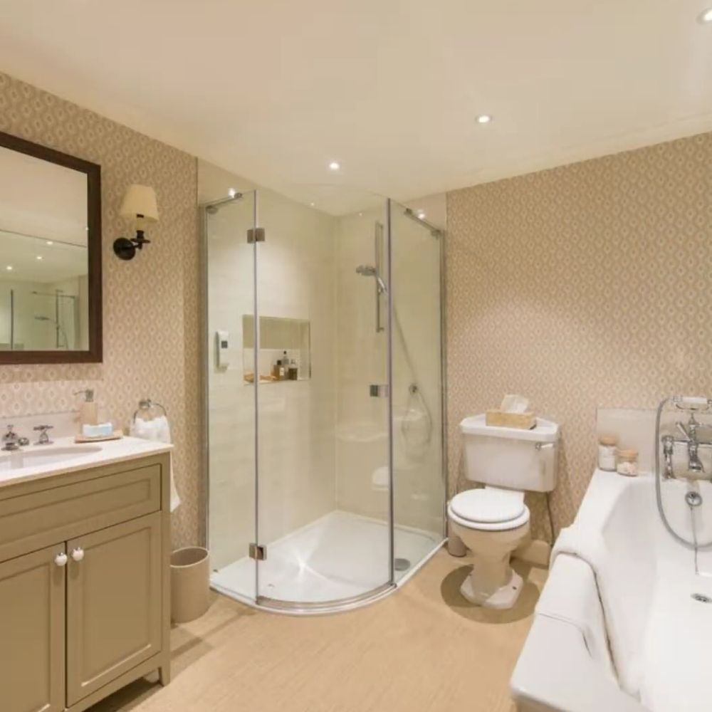 Traditional Silk Colored Bathroom With Walk In Shower