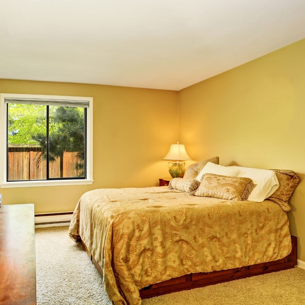 Traditional Yellow Bedroom With Yellow Cushions And Sheets