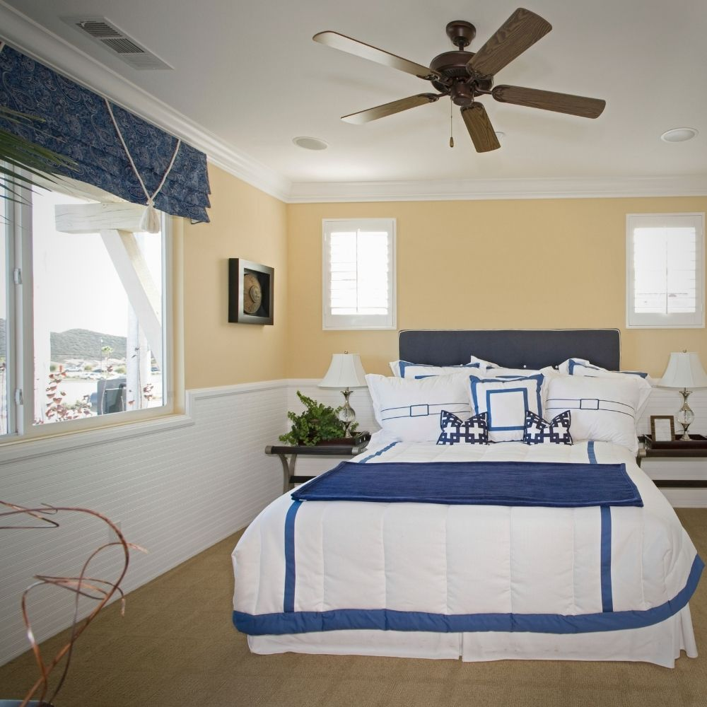 White Bedroom With Blue Accents And Coastal View
