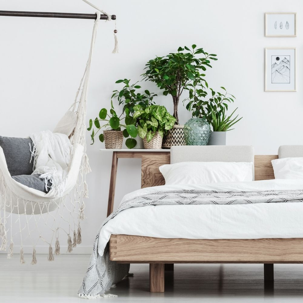 white bedroom with natural wood