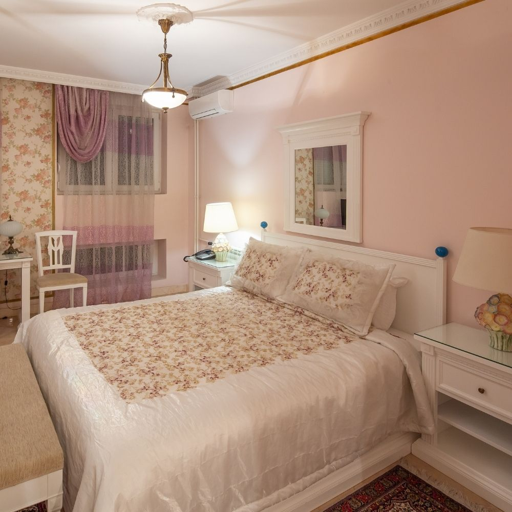 Blush Pink Traditional Bedroom With Floral Cushions