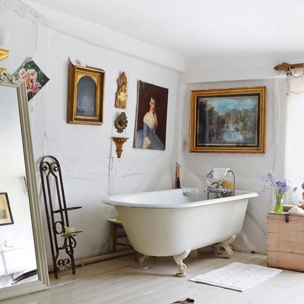 White Country Bathroom With Free Standing Claw Foot Bath And Wall Arts
