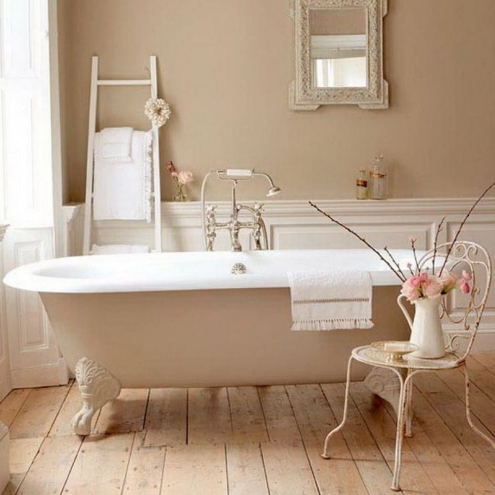 Country Bathroom With Free Standing Claw Foot Bath And Wood Panel Flooring