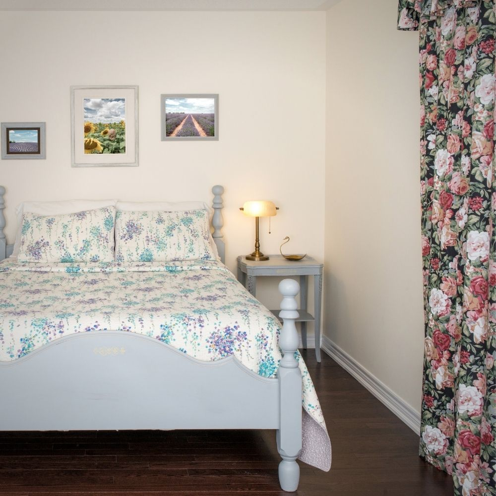 Country Bedroom With Floral Cushions Sheets And Curtain