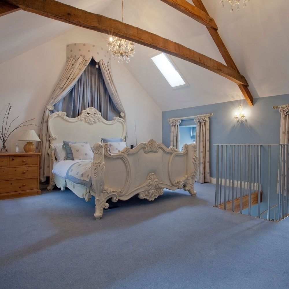 Luxurious Country Attic With Blue Wallpaper