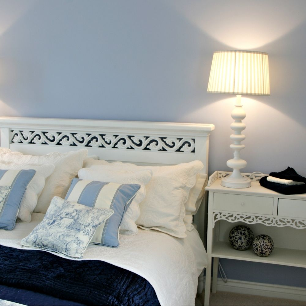 Modern Classic Bedroom With Solid Light Blue Wallpaper