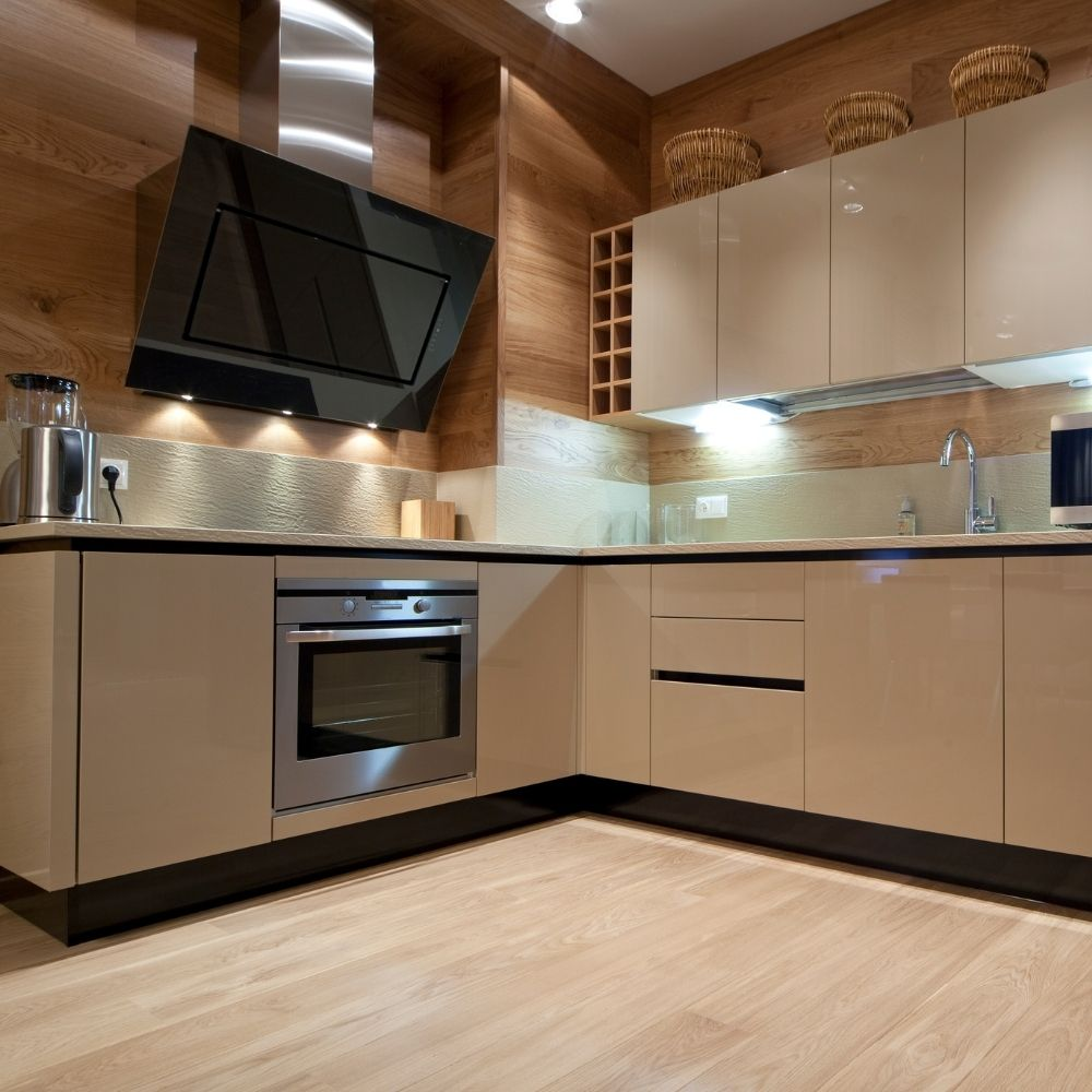 Modern Kitchen With Wood Walls And Knobless Shelves