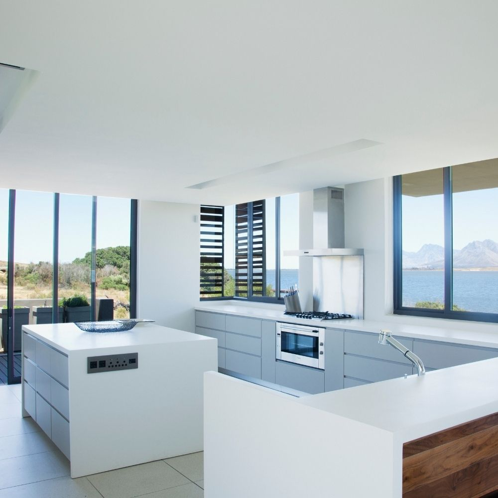 Modern White Kitchen With Blue Window Chrome Accents