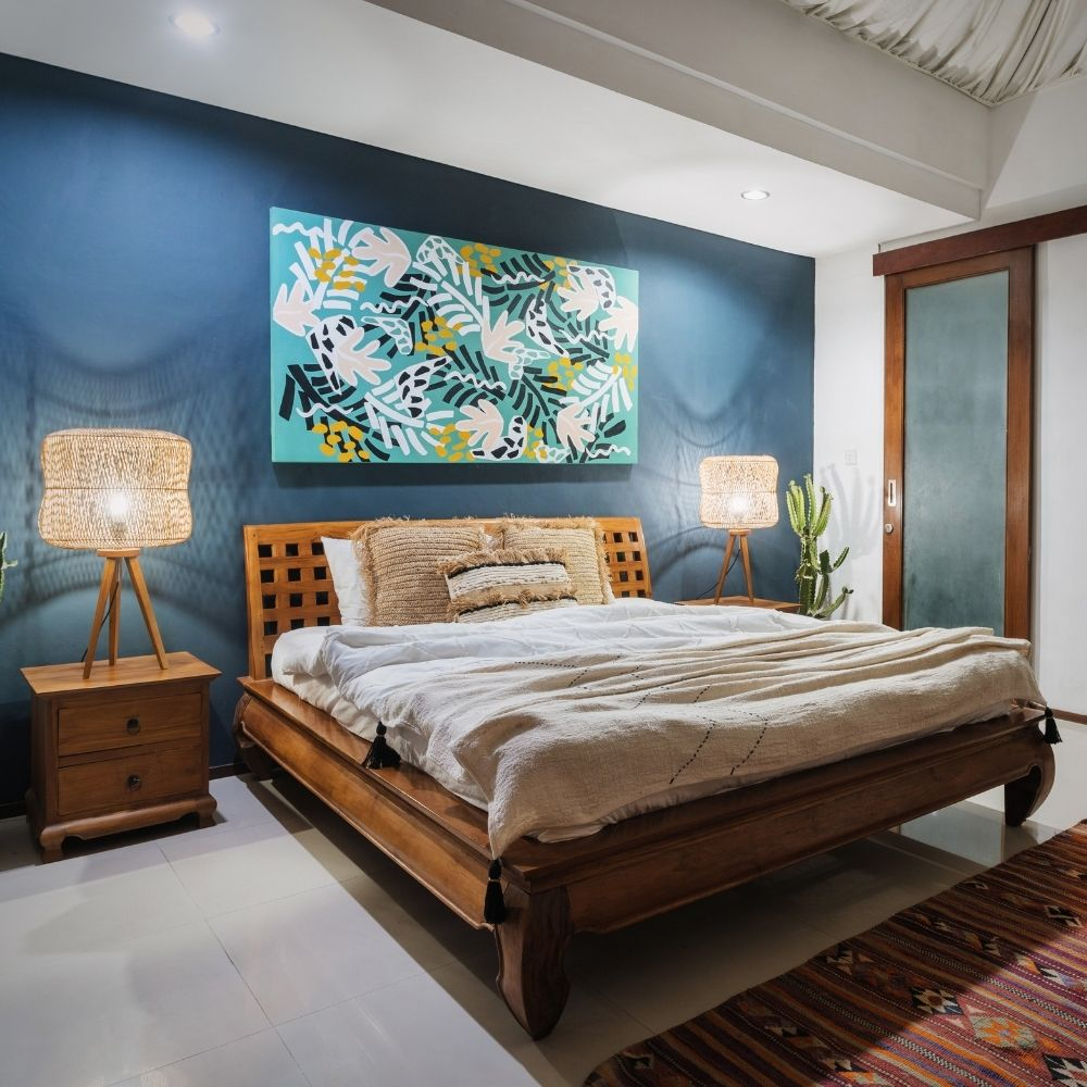 Navy Blue Traditional Bedroom With Overhead Wall Art
