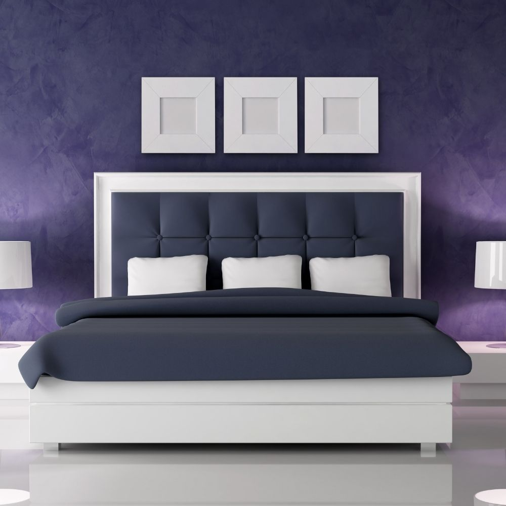 Purple Bedroom With Navy Sheets And Head Board