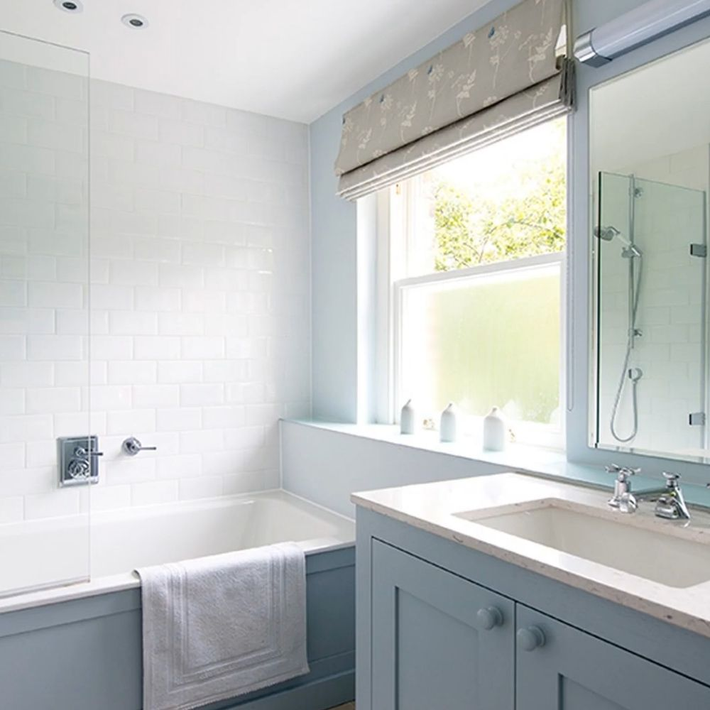 Small Traditional Bathroom With White and Periwinkle Colored Walls