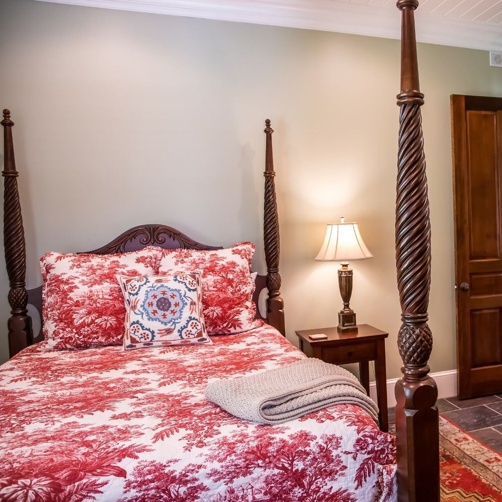 Traditional Bedroom With Cherry Cushions And Bed Pillars