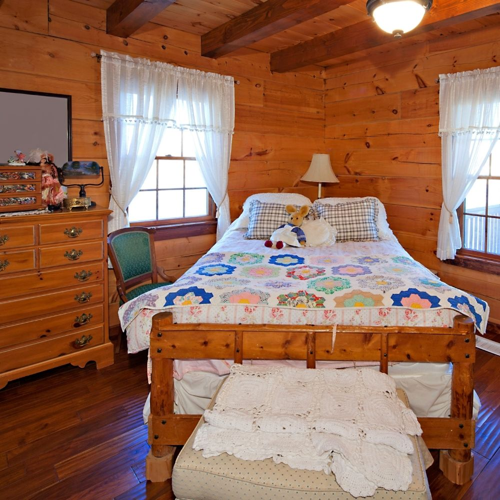 Traditional Cabin Bedroom With Exposed Wood Beams