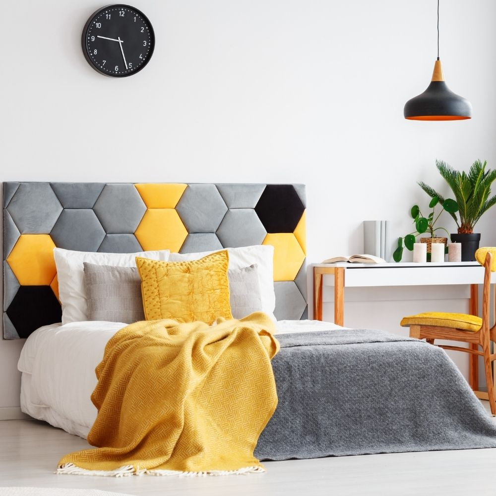 White Bedroom With Yellow Cushions