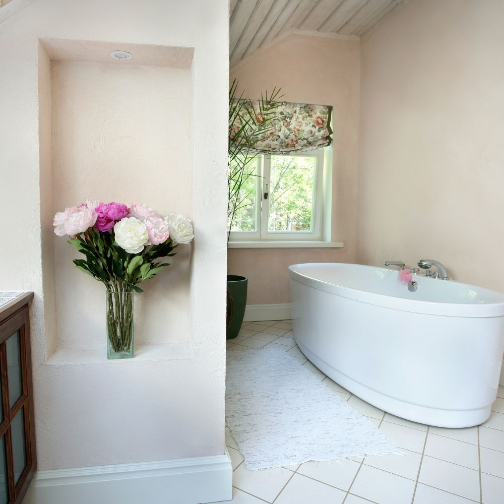 White Country Bathroom With Free Standing Tub And Beige Painted Wall