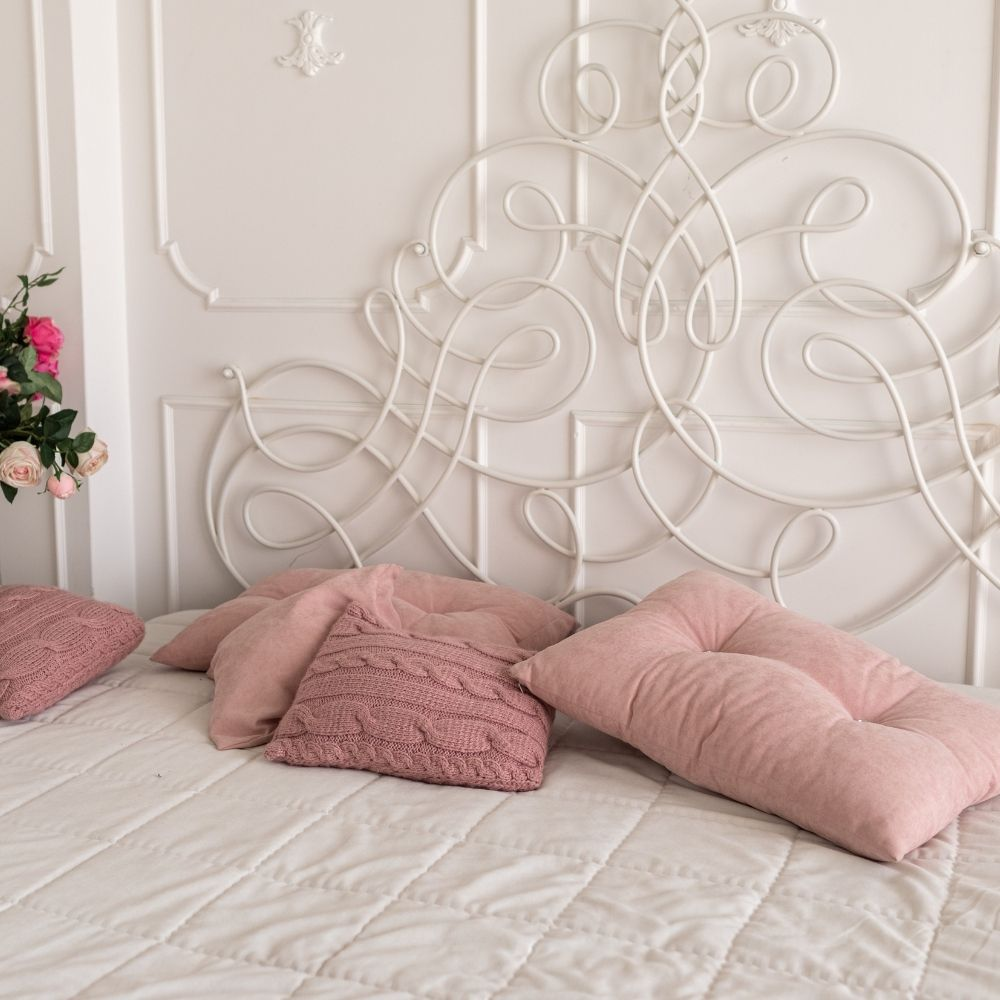 White Traditional Bedroom With Blushed Pink Cushions